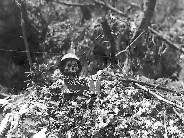 Front line warning sign using a Japanese soldier's skull on Peleliu